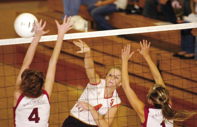 Steamboat Springs High School graduate Kacey Bull spikes the ball against Palisade High School in October 2008, her last season with Sailors volleyball. Bull and rising Steamboat senior Colleen King leave Tuesday to attend a Junior Olympic volleyball tournament in Miami. The two play on NORCO 18s Black, an elite club volleyball team based in Fort Collins.