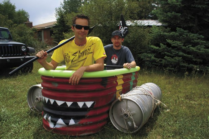 Jason Buys, front, and Steven Spalty plan to take their homemade craft down the Yampa River during the fourth annual BAF Wax Raft Regatta on Saturday. Registration for the float starts at 11 a.m. at the Walton Pond river access.