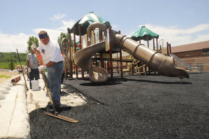 Tony Lauer works on the Strawberry Park Elementary School playground Wednesday afternoon.