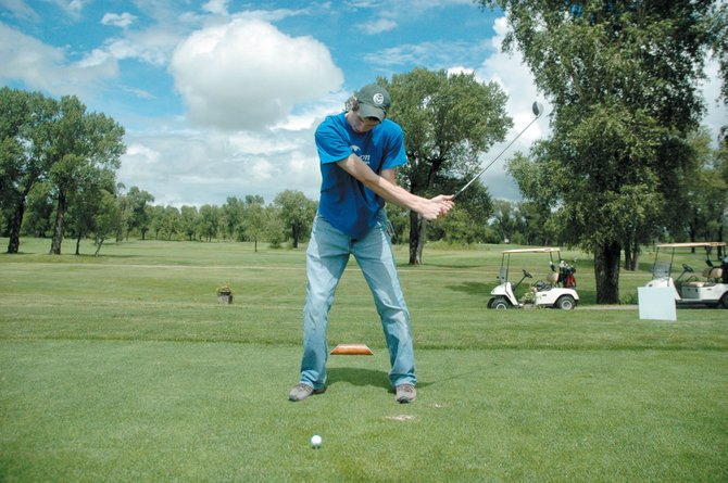 Jeff Jenison lines up his shot at Yampa Valley Golf Course on Friday. TMH Foundation Golf Tournament fundraiser attracted 128 golfers, local and from outside the area.