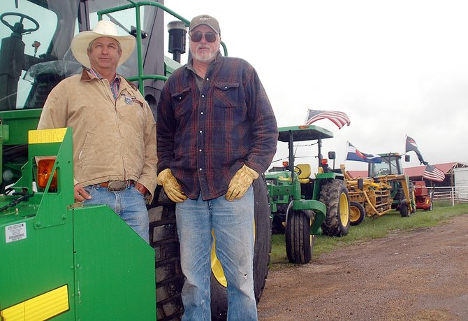 Jock Camilletti, left, and Bob Preator are set for what they said should be a great hay season. The men showed off their equipment Friday at the Camilletti property east of Hayden.
