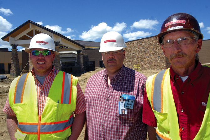 Officials stand in front of The Memorial Hospital's new facility west of town. Robins & Morton is the project's general contractor. From left are project superintendent Rob Kerns, TMH facilities supervisor Dave Mucha and assistant project superintendent Barry Rodgers.