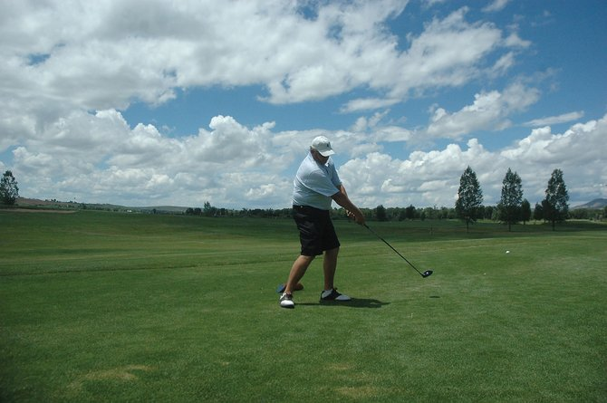 Joe Rukavina, of Grand Junction, tees off Friday afternoon at Yampa Valley Golf Course. Rukavina is one of 183 golfers participating in the 42nd annual Cottonwood Classic golf tournament.