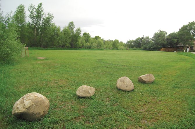 City officials are sparring with Riverside residents who historically have maintained a small city-owned piece of open space inside the subdivision. Residents have been mowing the area since the 1980s and have used the space as a small community park.