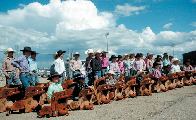 The winners of each Moffat County Little Britches Rodeo division and competition were awarded custom saddles. When the saddle presentation was over, the first-time winners were given a traditional dunk in a trough.