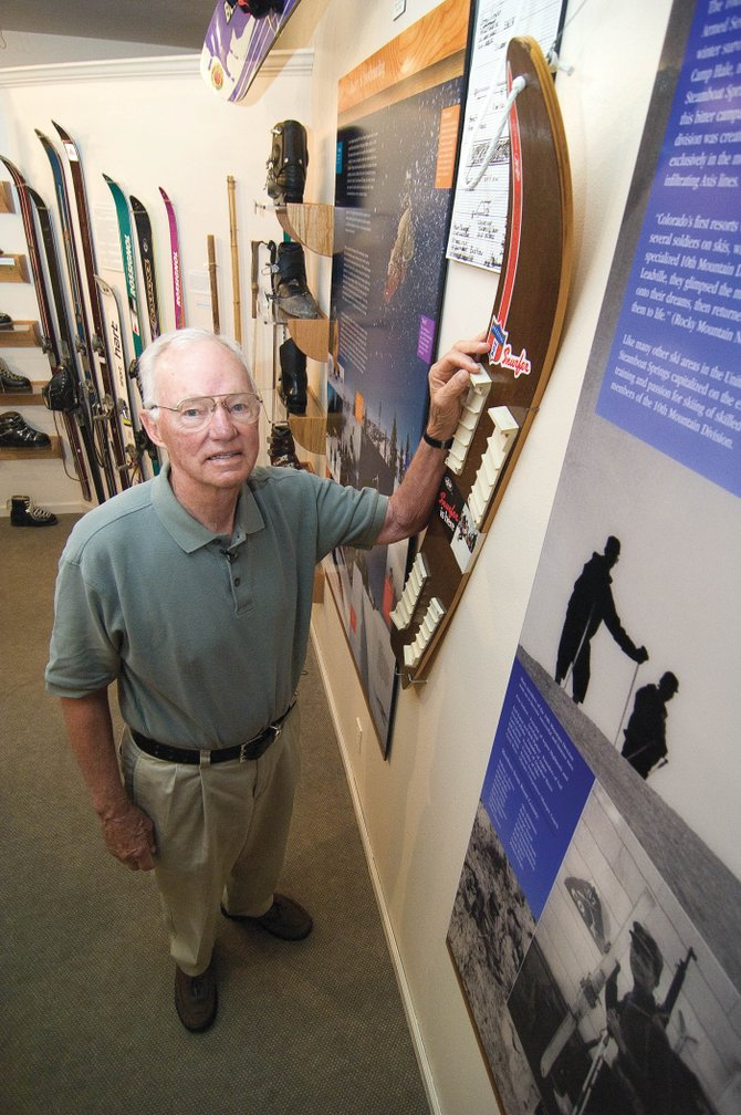 Sherman Poppen stands next to a 'Snurfer' at the Tread of Pioneers Museum. He invented the toy for his children, and it became the inspiration for today's snowboard. A collection of his Snurfers and marketing materials now are in the Smithsonian Institution.