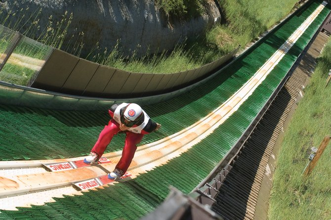 U.S. Ski Team member Taylor Fletcher races down the in-run of Howelsen Hill's plastic-covered ski jump Wednesday. Fletcher is one of several young athletes on the team that are pushing the veterans and vying for a place on the 2010 Vancouver Olympic Team.