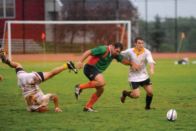 Steamboat Springs rugby player Chris Baumann, center, challenges two Wyoming players during Saturday&#39;s Cow Pie Classic Rugby Tournament championship game. The Steamboat Springs Rugby Club earned the title with a 5-0 win.