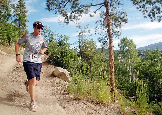 John Nyen heads down a trail on Howelsen Hill early Saturday in the Howelsen Hill 8-Miler. The day's events included 8- and 4-mile races on Howelsen's trail systems and drew racers from across the state.