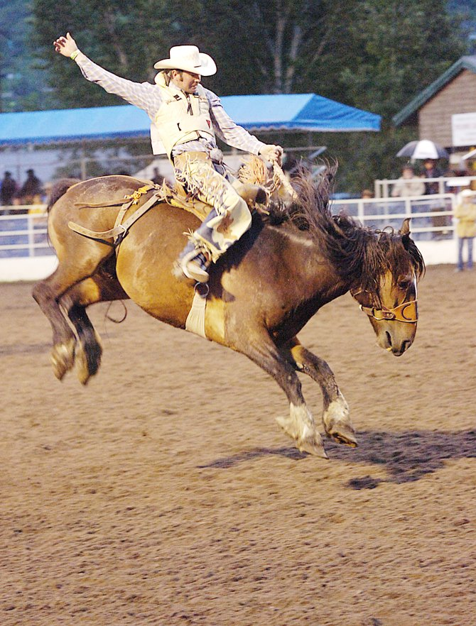 Pacer Lee tries to ride Ragu ealier this summer in the saddle bronc riding competition at the Steamboat Springs Pro Rodeo. The series will return at 7:30 p.m. today with the first of two weekend performances.