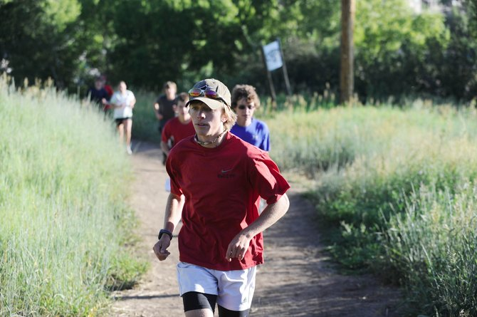 John Cutter, who will be attending University of San Diego in the fall, leads a pack of distance runners Thursday on Howelsen Hill. Steamboat Springs High School cross-country coach Greg Long has been holding running sessions throughout the summer in preparation for the upcoming season.