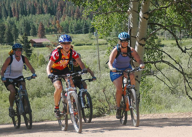 A Tailwind Tour group climbs a hill on Routt County Road 16 on Wednesday. Tailwind Tours began operations this summer, offering road and mountain bike tours across Steamboat Springs and the region.