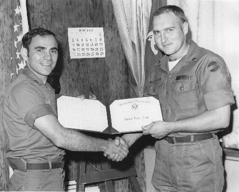 Robert Matteson, right, receives his honorable discharge from the Army in February 1973.