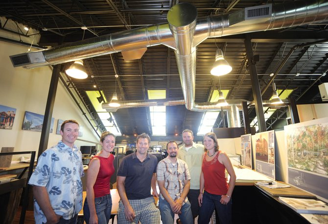Vertical Arts recently was awarded for outstanding achievement in design excellence by the American Institute of Architects Colorado West Chapter for the design of their office in Wildhorse Marketplace. Pictured are, from left, Travis Mathey, Katy Vaughn, Brandt Vanderbosch, Rob Nadolny, Brian Bavosi and Maureen McQuillin.