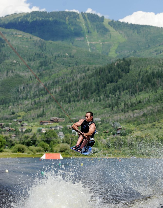 Matt Schallmoser, of Denver, jumps a wake during an adaptive water skiing camp Thursday at Bald Eagle Lake. The camp is a collaboration between Steamboat's Access Anything founders and Adaptive Adventures.