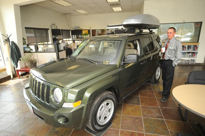 Steamboat Motors sales consultant Luke Berlet talks about the features of a 2009 Jeep Liberty, which Berlet said qualifies for the Car Allowance Rebate System.