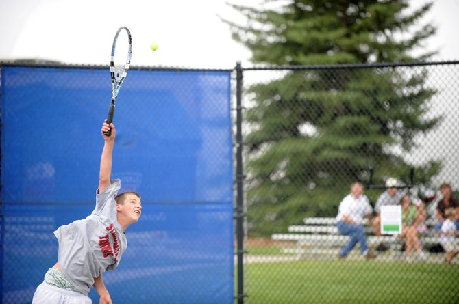 Jack Burger, 16, of Steamboat Springs, serves the ball during a Friday match. All eight members of the Burger family are participating in this weekend's Steamboat Tennis Association Championships.