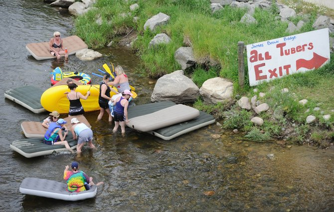 Tubers and rafters exit the Yampa River on Saturday afternoon. Tubes are being sold by the hundreds on some days in Steamboat Springs.