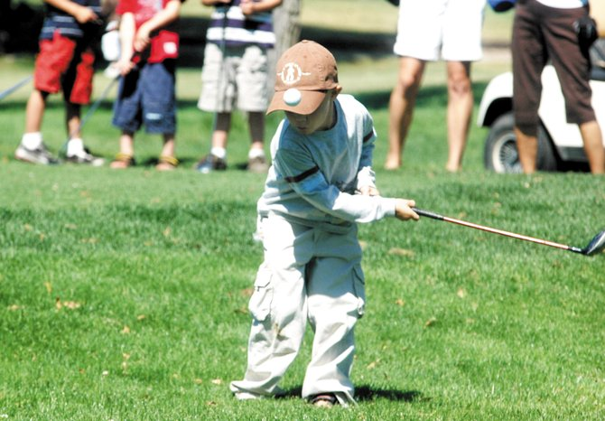 Cooper Stewart, 4, takes a swing at a ball Tuesday morning during the Yampa River Junior Classic at Yampa Valley Golf Course. More than 50 young golfers, from 4 to 18 years old, competed in the tournament.