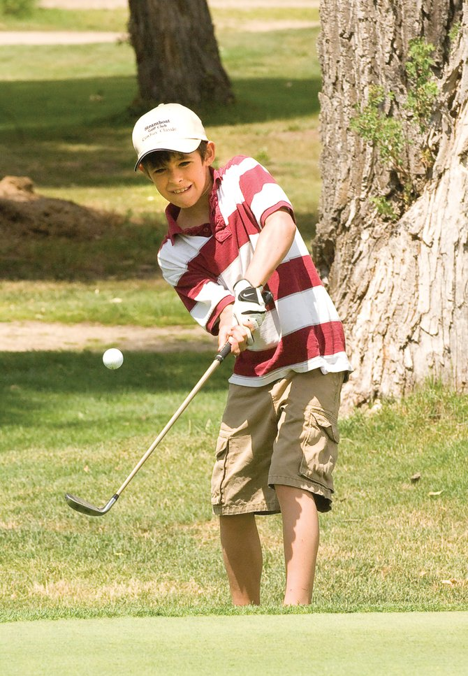 Junior golfer Billy Winters chips onto the No. 9 green at the Steamboat Golf Club during Wednesday's Steamboat Golf Club's Cowboy Shootout. Winters played in the 10- and 11-year-old age division.