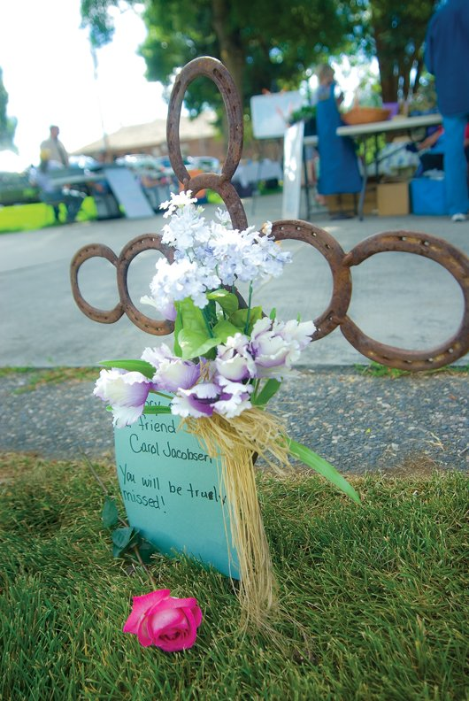 A memorial for Carol Jacobson was set up Thursday at the Craig Farmer's Market. Jennifer Stagner and Lorrae Moon set up the cross for Jacobson, who was instrumental in starting the market in Craig.