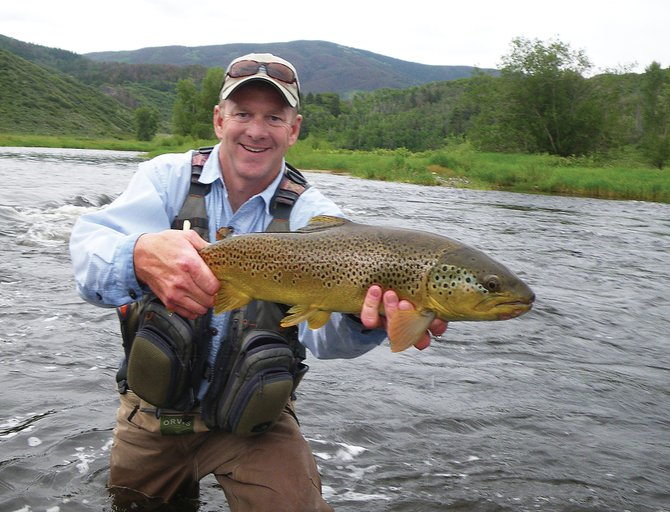 Co-listing Realtor Brian Smith feels obligated to take a fly rod with him whenever he shows Yampa Tailwaters Preserve to prospective clients. Rainbow trout are most common in this two-mile stretch of the Yampa River, but Smith caught this brown trout using a dark streamer on an overcast day.