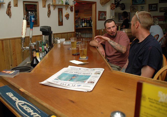 Despite the beers in front of them Thursday at Black Mountain Tavern, Oak Creek residents Matt Wood, left, and Lawrence Jaconetta debate the best way to make a margarita. Doug Diamond, the owner of the tavern, sold the business.