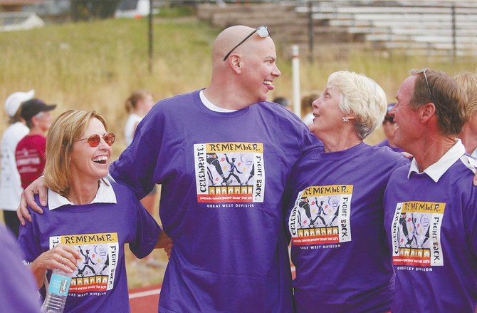 Jason Sear sticks out his tongue while walking with, from left, Sandy Jenny, Bev Engel and Keith Leifer during the Steamboat Springs American Cancer Society Relay For Life Survivor Walk on Aug. 8, 2008, at Steamboat Springs High School. Sear died May 11 after battling adrenocortical carcinoma.