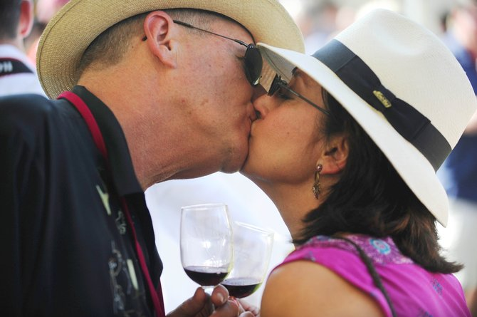 Dave Singer, of Lone Tree, and Denise Baumbach, of California, share a kiss Saturday during the Toast of Steamboat Grand Tasting at Torian Plum Plaza. Wine Festival at Steamboat Producer Doug Larson said about 1,200 to 1,500 attended the annual event.