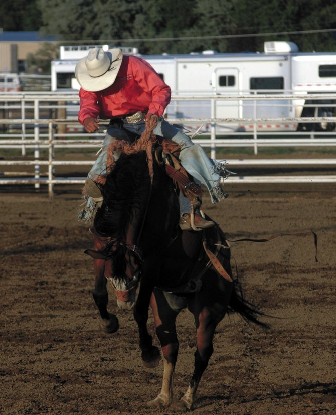 Colt Hamaker tries to conquer his bronco Saturday at the Wes Hertzog Memorial Bronc Match at the Moffat County Fairgrounds. Hamaker was one of more than 20 cowboys competing for a $4,000 purse and a new saddle.