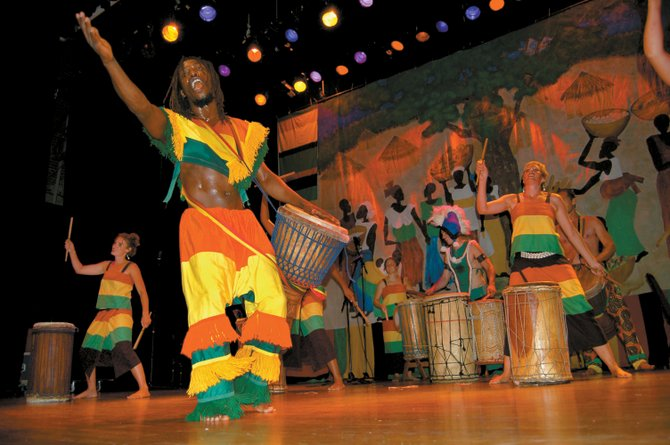 Fara Tolno, a master dancer and drummer from Guinea, West Africa, performs with the Kissidugu troupe at the Boulder Theater in 2008. Tolno and the Kissidugu troup will perform two shows Tuesday at Strings Music Pavilion.