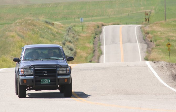 A sport utility vehicle makes its way along Routt County Road 14 on Monday morning. The Routt County Board of Commissioners is debating whether to spend $1 million to acquire a right of way along the road.