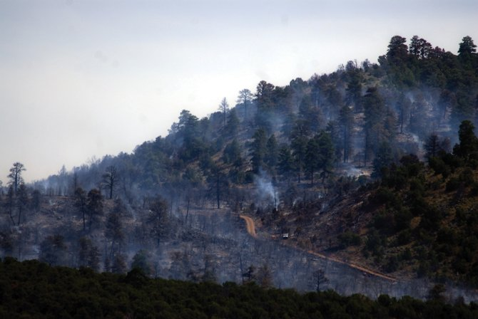 A wildfire 20 miles west of Maybell is estimated to have covered a 3,000-acre area, the Northwest Colorado Fire Management Unit reported. Firefighters said lightning caused the fire.