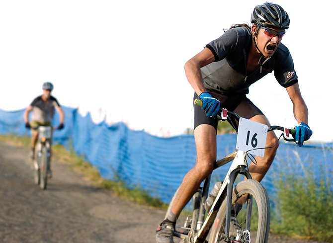 Essam Welch flies toward the finish line in the Dog Days of Summer Town Challenge mountain bike race Wednesday evening at Howelsen Hill. Welch finished fourth in the men's pro division. Brad Bingham won the division, and Kelly Boniface captured the women's open division.