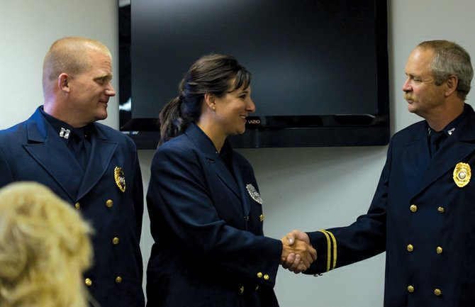 Craig Fire/Rescue promoted K.C. Hume, from left, Samantha Johnston and Dennis Jones to the ranks of battalion chief, lieutenant and battalion chief, respectively. The three received their new ranks during a special ceremony Thursday at the fire station.