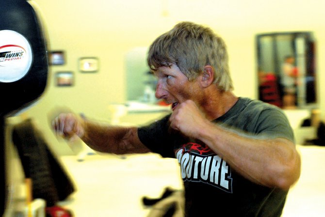 "Marc Leier, 39, started cage fighting in 2007. He said that if the sport had been popular when he was younger, he would have dedicated more of his life to the sport. Tonight, he will compete in his last fight during the ""Rampage in the Cage"" event at the Moffat County Ice Arena."