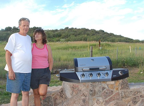 Ken and Terri Carpenter fear that summer evenings on their new patio won't be the same if the New Victory Highway carries traffic just across their fenceline in a desgnated greenbelt.
