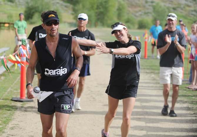 Will Laughlin crosses the finish line of the Wild West Relay on Saturday with his wife, Beth.