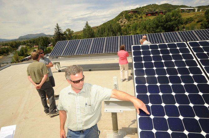 Emerald Mountain Energy co-owner Tim McCarthy talks Wednesday about the new solar panels installed earlier this month on the roof of Bud Werner Memorial Library.