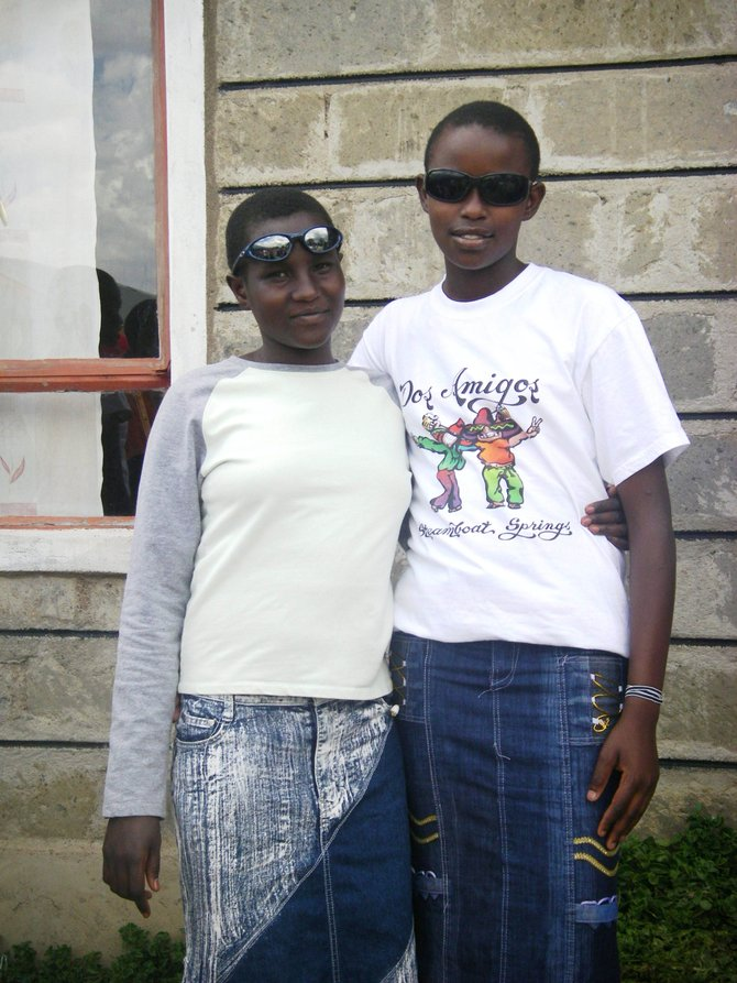 Two friends stand together at the Tasaru Girls Rescue Centre in Narok, Kenya, where Routt County resident Mary Walker is a volunteer. One of the girls is sporting a T-shirt from former Ski Time Square restaurant Dos Amigos.