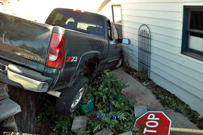 A Chevy truck owned by Ricky Kawcak, which was reported stolen, crashed Tuesday night into the side of Al Cashion's garage at the corner of Sandrock Road and Barclay Street. The driver of the truck fled the scene and is still unknown. Craig police are investigating the incident.