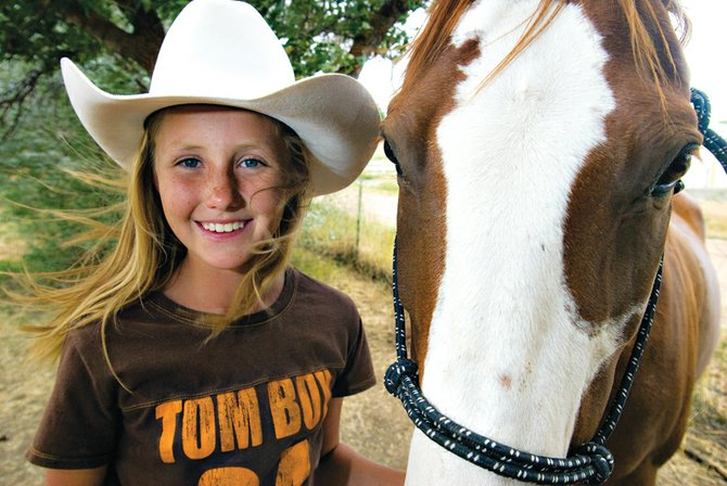 Mattie Jo Duzik, 10, was the named first runner-up in the National Little Britches Rodeo Association Royalty Pageant last month in Pueblo, which she achieved with her horse, Chunky. Mattie Jo spent six months preparing for the 10-day event, which took her out of her normal comfort zone as a rodeo girl.