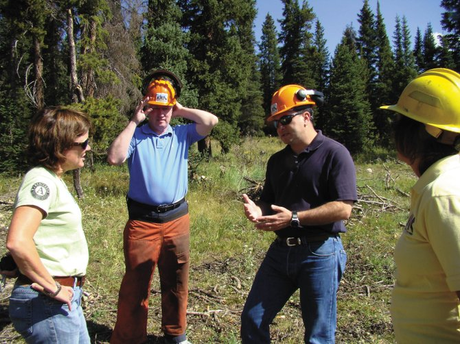 Rocky Mountain Youth Corps leaders Sheila Wright, left, and Gretchen Van de Carr, right, talk with Colorado Senate Majority Leader John Morse, with  hands on head, and state Senate President Brandon Shaffer on Wednesday near Buffalo Park Road on Rabbit Ears Pass. The two Democratic politicians visited Northwest Colorado as part of a tour across the state this summer.