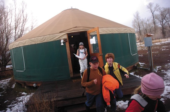 North Routt Community Charter School students file out of the school's yurt after class in November 2008. Although the yurt is stable and innovative, state officials cited it as evidence of needed structural improvements when awarding a $3.1 million grant for a new charter school.