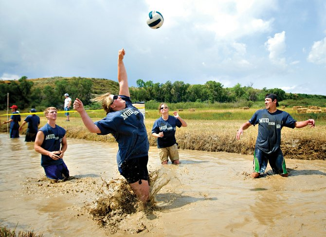"Annie MacGregor returns a pass for her team ""The Mudder Chuckers"" Saturday at the 10th annual Mud Splash mud volleyball tournament at Loudy-Simpson Park. The event, sponsored by the Craig Chamber of Commerce, pits teams against each other in knee-high mud."