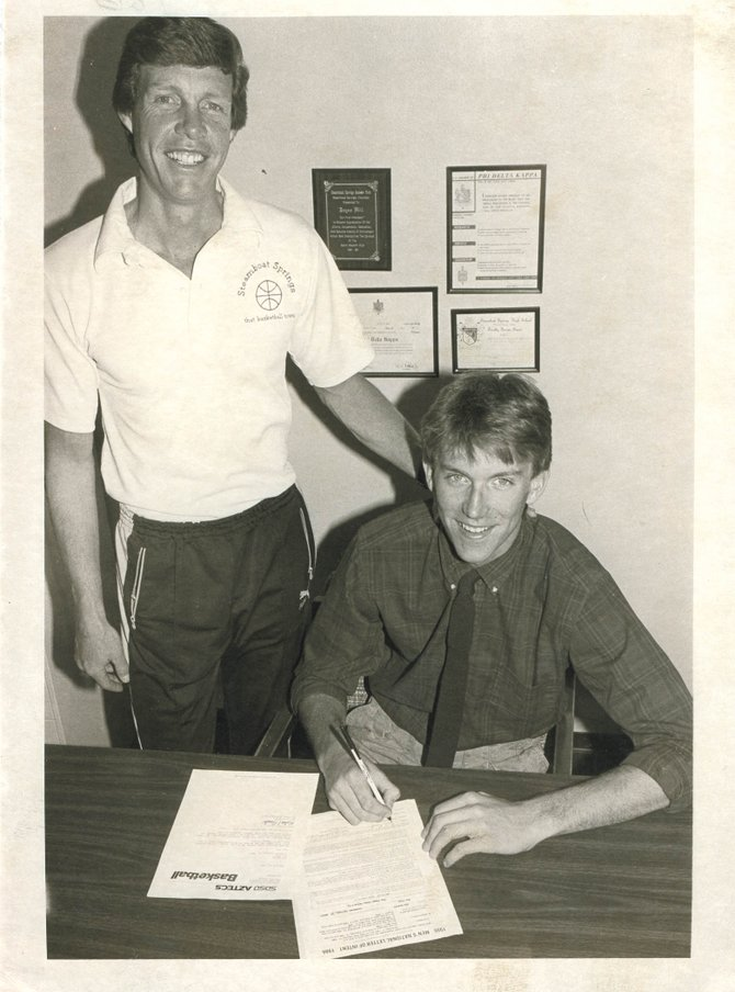 Jon Baskin, right, signs his letter of intent to play basketball at San Diego State University with coach Kelly Meek in 1986. Baskin recently was named to the All-Time Rocky Mountain Athletic Conference basketball team.