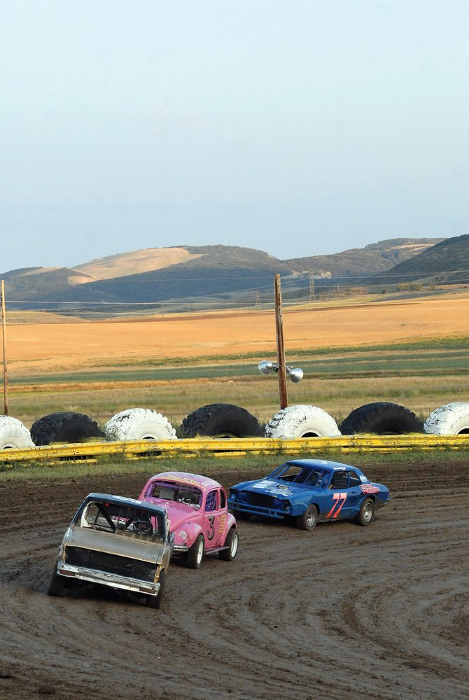 Travis Goodwin, left, Carolyn Gochee, center, and Isadora Hitz line up during a caution Saturday night. Goodwin, Gochee and Hitz finished first, second and third, respectively, in the Sport Stock class Saturday night at the Hayden Speedway.