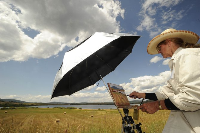 "Steamboat Springs artist and author Bonnie McGee works on a plein air piece Tuesday overlooking Lake Catamount. She will talk about her book, ""Voices on the Wind,"" on Thursday as part of the Steamboat All Arts Festival."