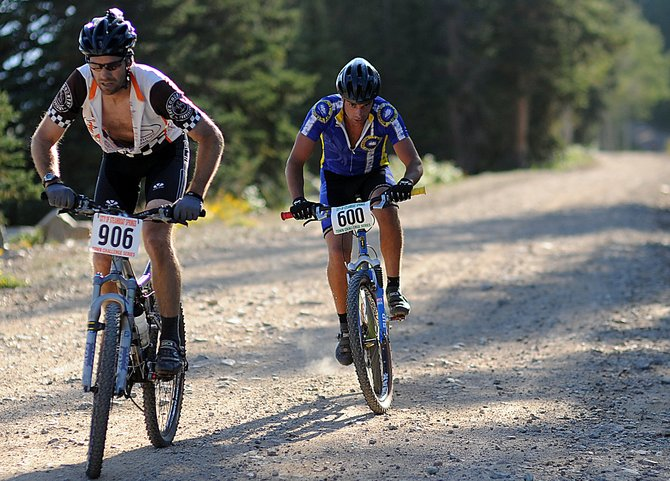 Matt Heydon, left, and Jale Smith fight their way up the Buffalo Pass road Wednesday evening during the Buff Pass Hill Climb Town Challenge mountain bike race near Steamboat Springs. Barkley Robinson won the race, finishing the grueling 11-mile course in 58 minutes, 48 seconds.