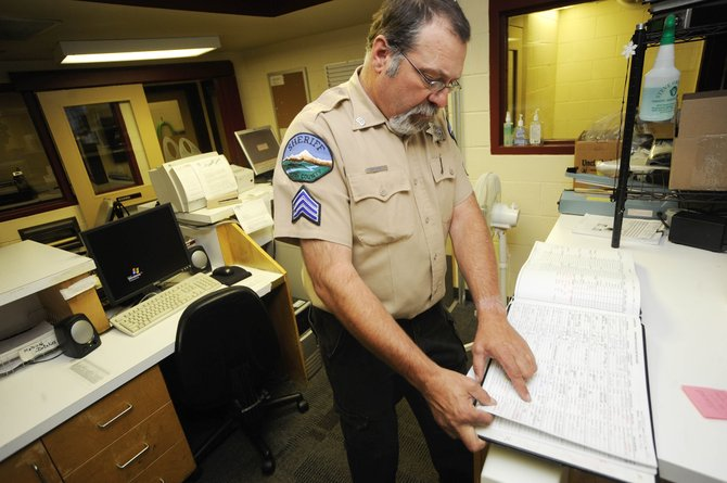 Routt County Jail Sgt. Dave Schulz looks through bookings Wednesday while talking about population levels at the jail.